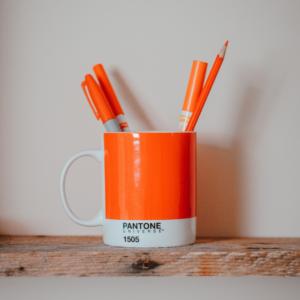Orange markers in orange pantone mug